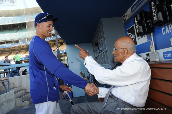Trayce Thompson shakes the hand of Don Newcombe on his 90th birthday prior to game against the Colorado Rockies Wednesday, June 8, 2016 at Dodger Stadium in Los Angeles,California. Photo by Jon SooHoo/© Los Angeles Dodgers,LLC 2016