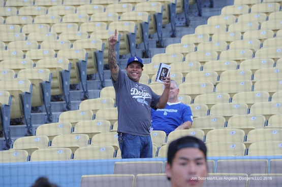 Great Los Angeles Dodger fan waves prior to game against the Colorado Rockies Wednesday, June 8, 2016 at Dodger Stadium in Los Angeles,California. Photo by Jon SooHoo/© Los Angeles Dodgers,LLC 2016