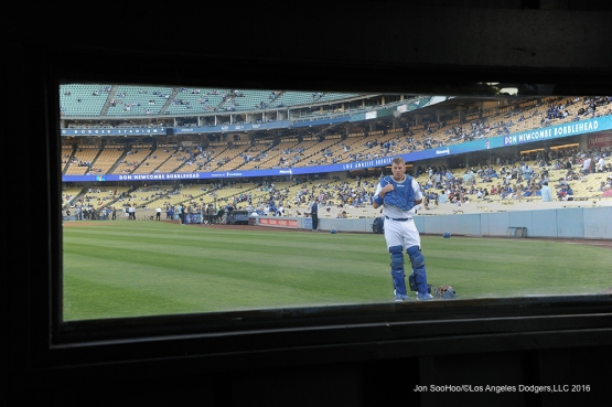 A.J.Ellis through the bullpen window prior to game against the Colorado Rockies Wednesday, June 8, 2016 at Dodger Stadium in Los Angeles,California. Photo by Jon SooHoo/© Los Angeles Dodgers,LLC 2016
