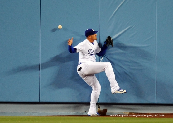 Trayce Thompson slams into the wall in centerfield attempting to make a play on a fly ball.