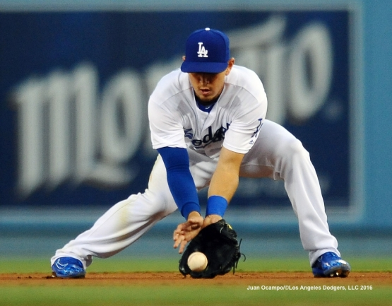 Austin Barnes fields the ground ball.