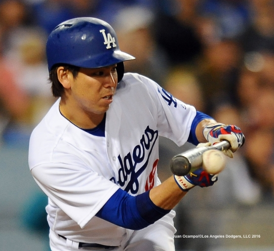 Kenta Maeda lays down the sacrifice bunt in the fifth inning.