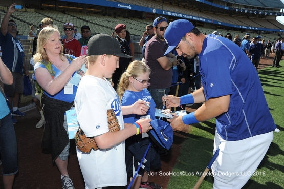 Great Los Angeles Dodger fans get autograph from Adrian Gonzalez prior to game against the Milwaukee Brewers Thursday, June 16, 2016 at Dodger Stadium. Photo by Jon SooHoo