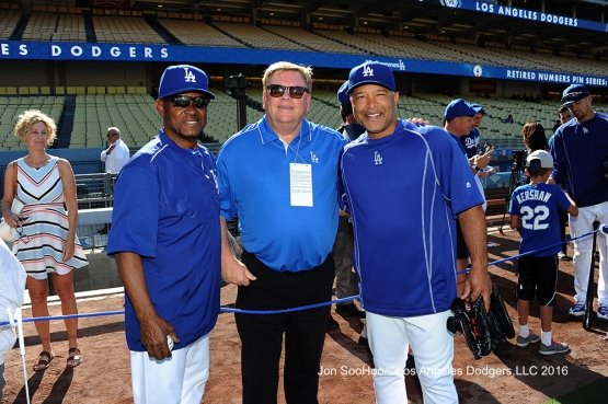 Great Los Angeles Dodger fan poses with Manny Mota and Dave Roberts prior to game against the Milwaukee Brewers Thursday, June 16, 2016 at Dodger Stadium. Photo by Jon SooHoo