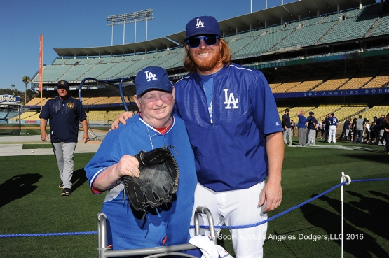 Great Los Angeles Dodger fan poses with Justin Turner prior to game against the Milwaukee Brewers Thursday, June 16, 2016 at Dodger Stadium. Photo by Jon SooHoo