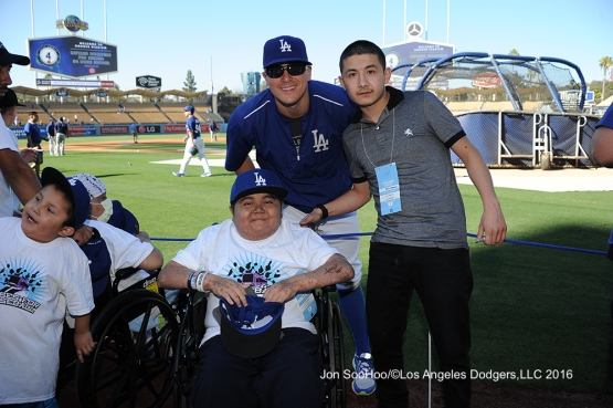 Great Los Angeles Dodger fans pose with Kike Hernandez prior to game against the Milwaukee Brewers Thursday, June 16, 2016 at Dodger Stadium. Photo by Jon SooHoo