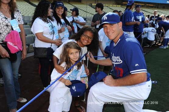 Great Los Angeles Dodger fans pose with A.J. Ellis prior to game against the Milwaukee Brewers Thursday, June 16, 2016 at Dodger Stadium. Photo by Jon SooHoo