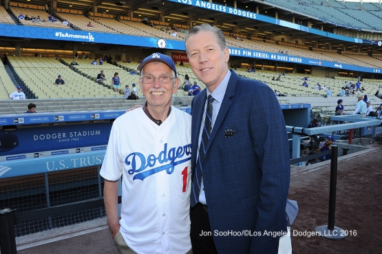Great Los Angeles Dodger fan poses with Orel Hershiser prior to game against the Milwaukee Brewers Thursday, June 16, 2016 at Dodger Stadium. Photo by Jon SooHoo