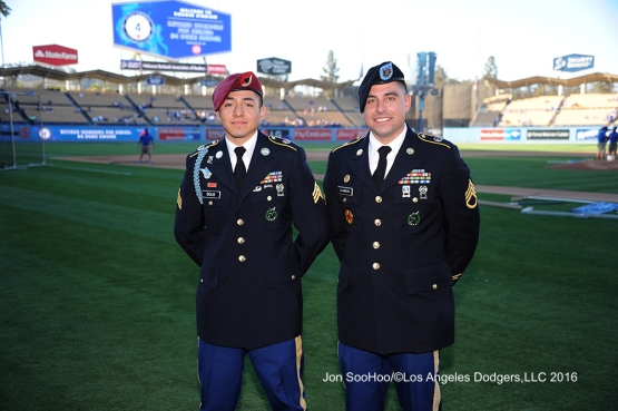 Great Los Angeles Dodger fans and Military Heroes of the game pose prior to game against the Milwaukee Brewers Thursday, June 16, 2016 at Dodger Stadium. Photo by Jon SooHoo