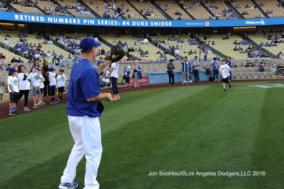 Great Los Angeles Dodger fan warms up with A.J. Ellis prior to game against the Milwaukee Brewers Thursday, June 16, 2016 at Dodger Stadium. Photo by Jon SooHoo