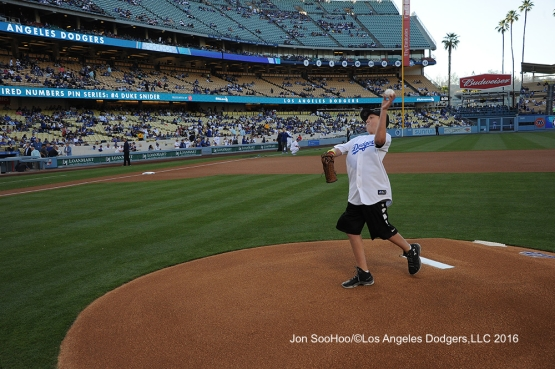 Carson Cook throws out the first pitch prior to game against the Milwaukee Brewers Thursday, June 16, 2016 at Dodger Stadium. Photo by Jon SooHoo