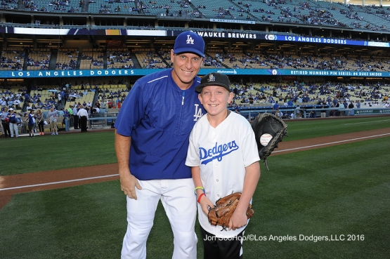 Carson Cook poses with A.J.Ellis prior to game against the Milwaukee Brewers Thursday, June 16, 2016 at Dodger Stadium. Photo by Jon SooHoo