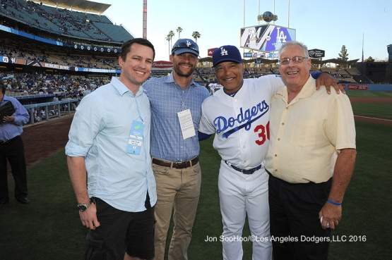 The Snider family poses with Dave Roberts prior to game against the Milwaukee Brewers Thursday, June 16, 2016 at Dodger Stadium. Photo by Jon SooHoo