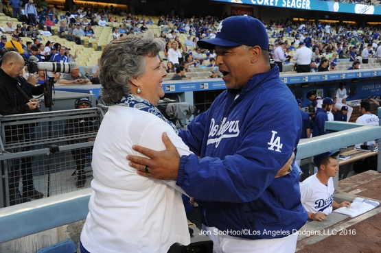 Sherri Patton and Dave Roberts embrace prior to game against the Milwaukee Brewers Thursday, June 16, 2016 at Dodger Stadium. Photo by Jon SooHoo