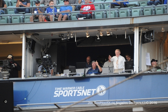 Vin Scully waves to the umpires prior to game against the Milwaukee Brewers Thursday, June 16, 2016 at Dodger Stadium. Photo by Jon SooHoo