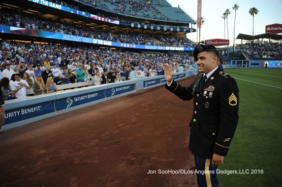 Military Hero of the Game, US Army Sergeant, Jeffrey Blumberg is honored during game against the Milwaukee Brewers Thursday, June 16, 2016 at Dodger Stadium. Photo by Jon SooHoo