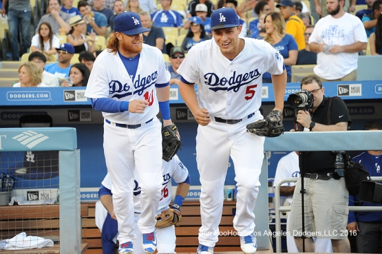 Justin Turner and Corey Seager take the field for game against the Milwaukee Brewers Friday, June 17, 2016 at Dodger Stadium. Photo by Jon SooHoo