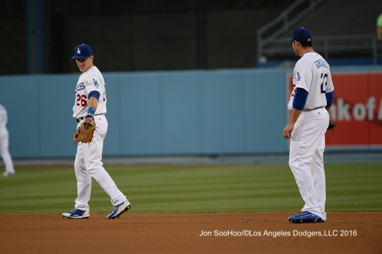 Chase Utley and Adrian Gonzalez discuss territory against the Milwaukee Brewers Friday, June 17, 2016 at Dodger Stadium. Photo by Jon SooHoo