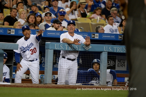 Dave Roberts and Bob Geren yell to ump during game against the Milwaukee Brewers Friday, June 17, 2016 at Dodger Stadium. Photo by Jon SooHoo