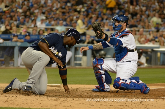 Yasmani Grandal makes the tag against the Milwaukee Brewers Friday, June 17, 2016 at Dodger Stadium. Photo by Jon SooHoo