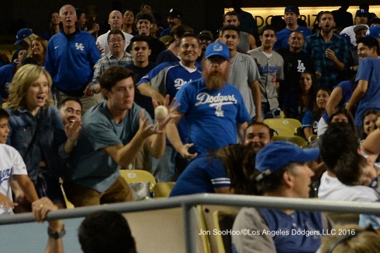 Great Los Angeles Dodger fan catches foul ball during game against the Milwaukee Brewers Friday, June 17, 2016 at Dodger Stadium. Photo by Jon SooHoo