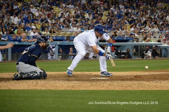 A.J. Ellis bunts during game against the Milwaukee Brewers Friday, June 17, 2016 at Dodger Stadium. Photo by Jon SooHoo