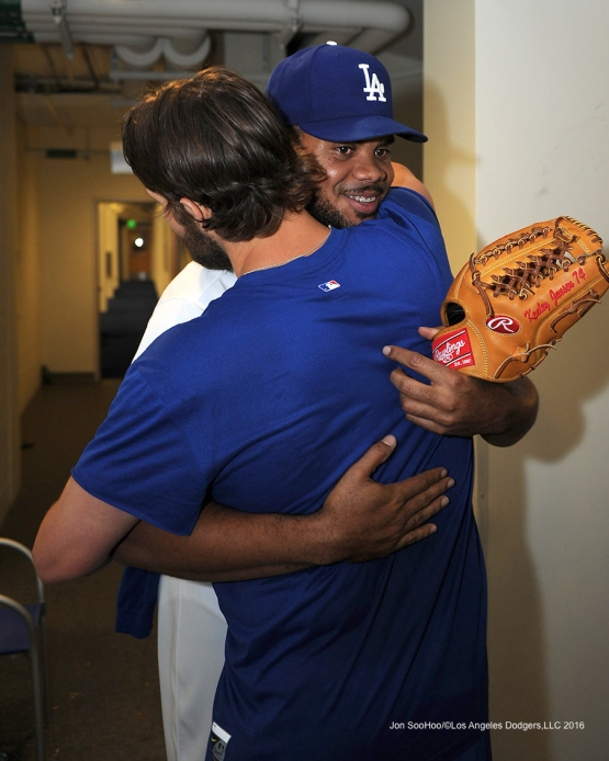 Los Angeles Dodgers Kenley Jansen hugs Clayton Kershaw after win against the Washington Nationals Monday, June 20,2016 at Dodger Stadium. Photo by Jon SooHoo/©Los Angeles Dodgers,LLC 2016