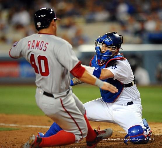 Yasmani Grandal tags out the Nationals' Wilson Ramos at home in the eighth inning.