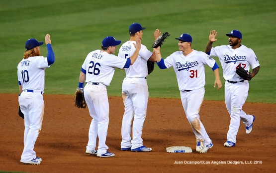 The Dodgers celebrate their 3-2 win over the Nationals.