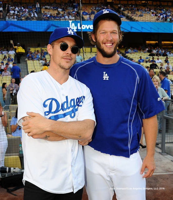 Diplo and Clayton Kershaw pose for a photo before the game.