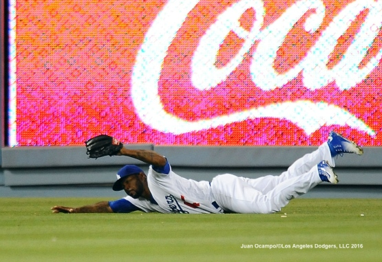 Howie Kendrick makes a sliding catch in the seventh inning.
