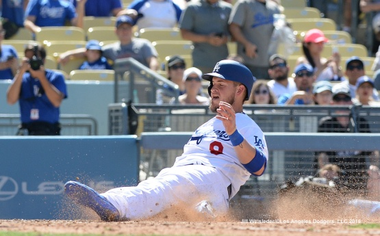 Yasmani Grandal slides home safely. Jill Weisleder/Dodgers