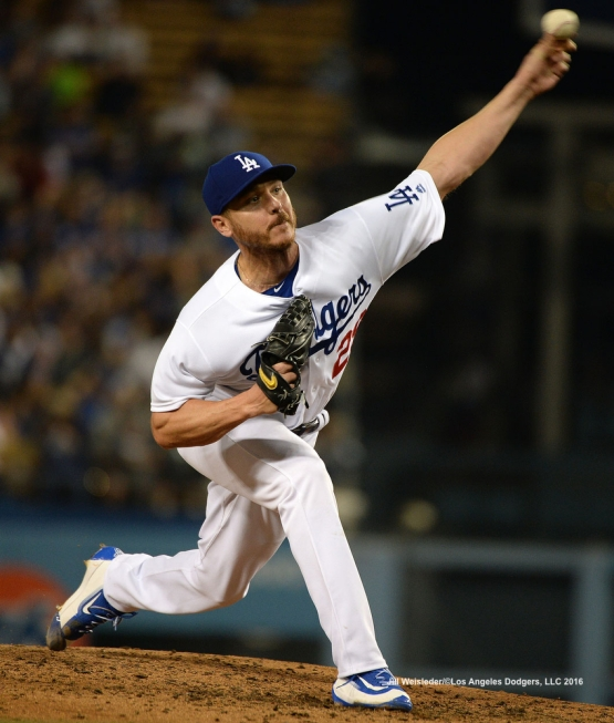 Starting pitcher Scott Kazmir throws on the mound against the Milwaukee Brewers. Jill Weisleder/Dodgers