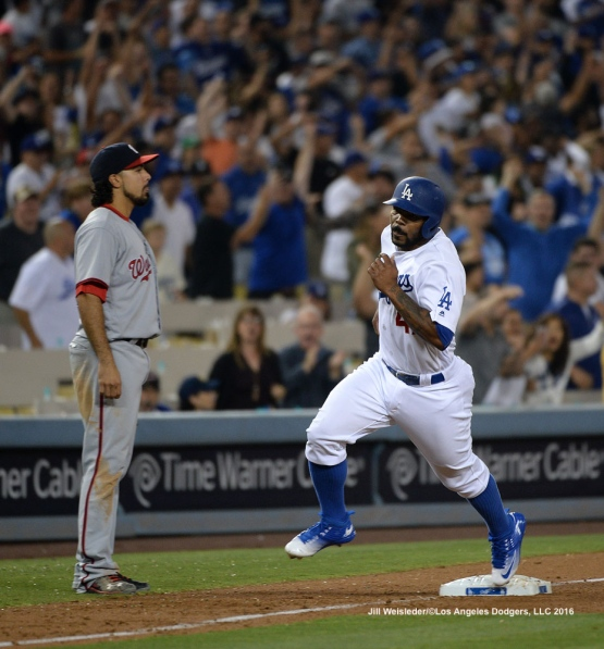 Howie Kendrick rounds the base to score in a run. Jill Weisleder/Dodgers