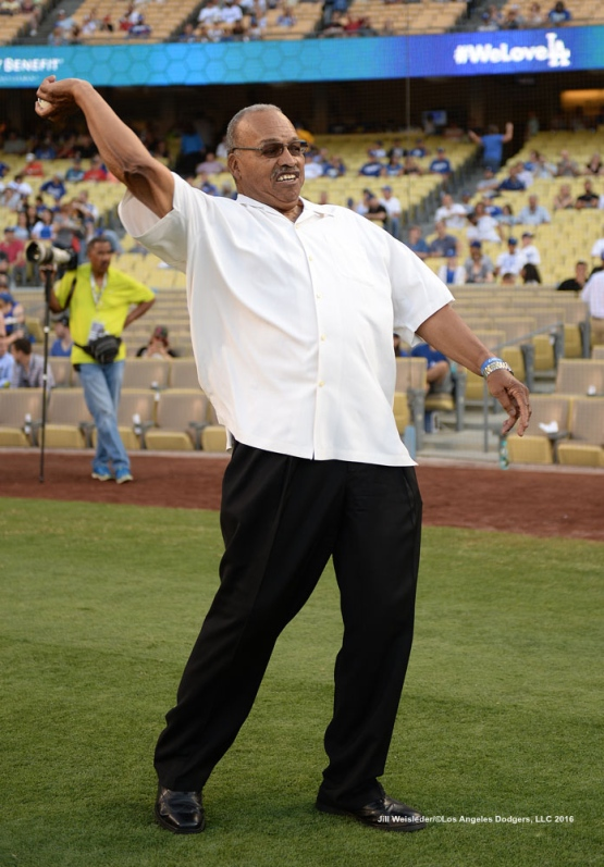Former Dodger Tommy Davis warms up for the ceremonial first pitch prior to the game. Jill Weisleder/Dodgers