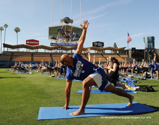 Dodger coach George Lombard participates in Yoga Day on the field after the game. Jill Weisleder/Dodgers