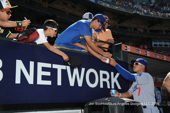 Julio Urias signs for fans prior to game against the San Francisco Giants Saturday, June 11, 2016 at AT&T Park in San Francisco, California. Photo by Jon SooHoo/© Los Angeles Dodgers,LLC 2016