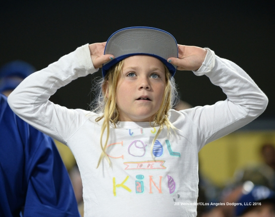 A young Dodger fan watches the game. Jill Weisleder/Dodgers