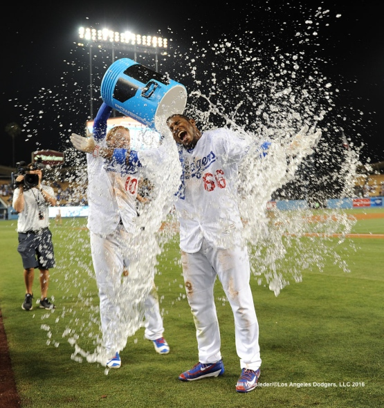 Justin Turner gives Yasiel Puig an ice water bath in celebration of the Dodgers sweeping the Nationals. Jill Weisleder/Dodgers