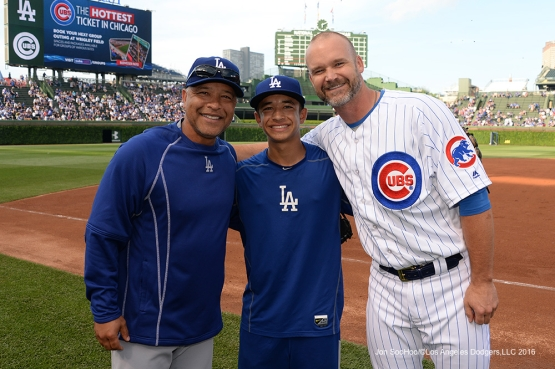 Los Angeles Dodgers Dave and Cole Roberts pose with David Ross  Wednesday, June 1,2016 at Wrigley Field in Chicago,Illinois. Photo by Jon SooHoo/©Los Angeles Dodgers,LLC 2016