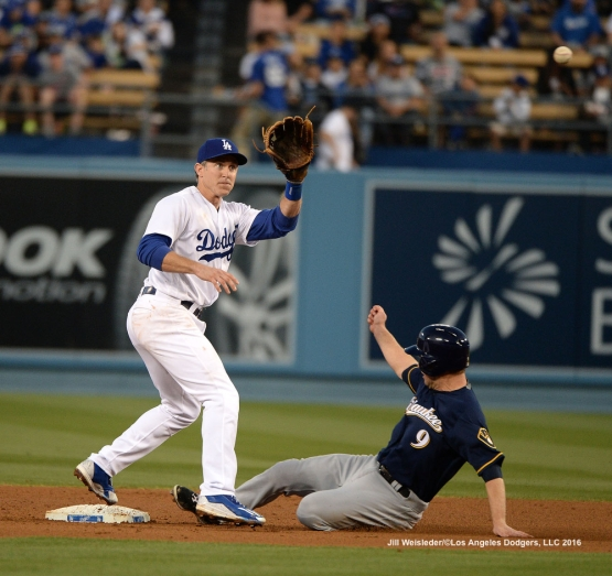 Milwaukee Brewers Aaron Hill slides safely under the glove of Chase Utley at second base. Jill Weisleder/Dodgers