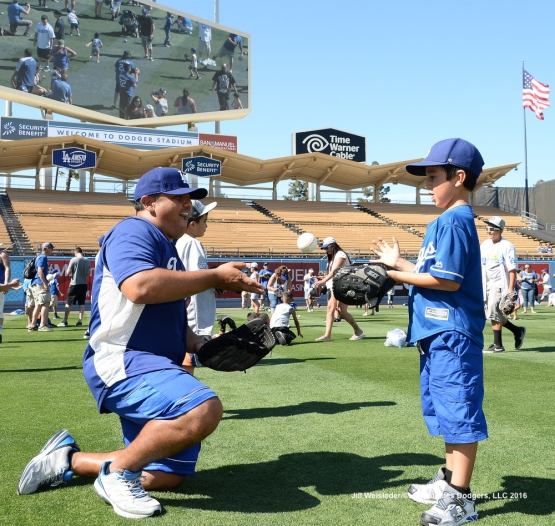 A father and son play catch on the field after the game. Jill Weisleder/Dodgers