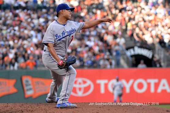 Los Angeles Dodgers Julio Urias throws to first against the San Francisco Giants Sunday, June 12, 2016 at AT&T Park in San Francisco, California. Photo by Jon SooHoo/© Los Angeles Dodgers,LLC 2016