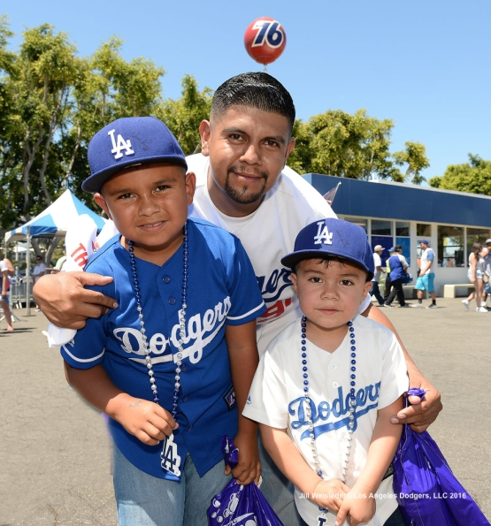 Dodger fans pose for a photo during Viva Los Dodgers festivities. Jill Weisleder/Dodgers