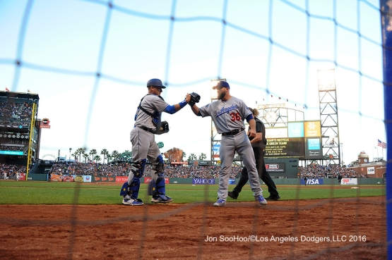 A.J.Ellis and Adam Liberatore high five during game against the San Francisco Giants Sunday, June 12, 2016 at AT&T Park in San Francisco, California. Photo by Jon SooHoo/© Los Angeles Dodgers,LLC 2016