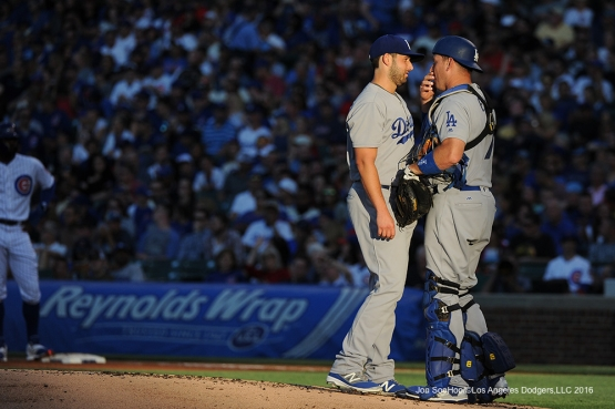 Los Angeles Dodgers Mike Bolsinger and A.J. Ellis talk vs the Chicago Cubs Wednesday, June 1,2016 at Wrigley Field in Chicago,Illinois. Photo by Jon SooHoo/©Los Angeles Dodgers,LLC 2016