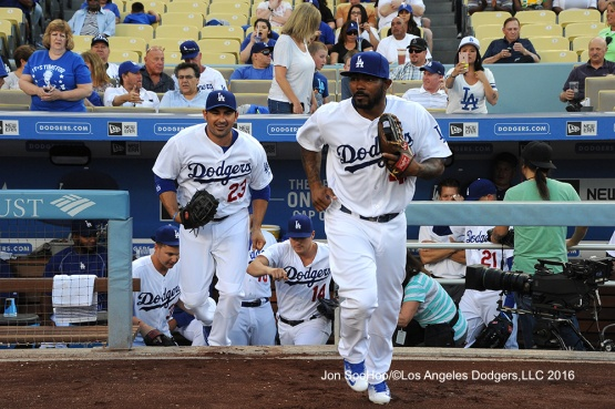 Los Angeles Dodgers Adrian Gonzalez and Howie Kendrick take the field for game against the Milwaukee Brewers Satuday, June 18, 2016 at Dodger Stadium. Photo by Jon SooHoo