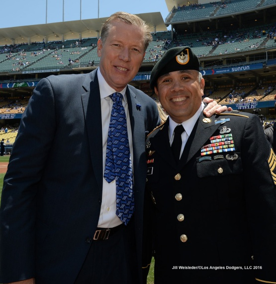 U.S. Army Master Sergeant David Nolan poses for a photo with all time Dodger legend Orel Hershiser prior to the start of the game against the Atlanta Braves. Jill Weisleder/Dodgers