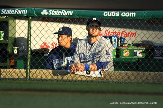 Los Angeles Dodgers Kenta Maeda and Yasmani Grandal in the dugout during game vs the Chicago Cubs Wednesday, June 1,2016 at Wrigley Field in Chicago,Illinois. Photo by Jon SooHoo/©Los Angeles Dodgers,LLC 2016