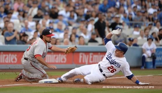 Chase Utley slides safely under the glove of Washington Nationals third baseman Anthony Rendon. Jill Weisleder/Dodgers
